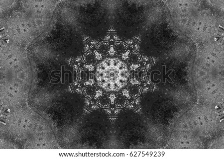 Grunge background of black and white. Shapes kaleidoscope. Abstract texture of scratch, dust, smudges and lines. Black and white old background for text