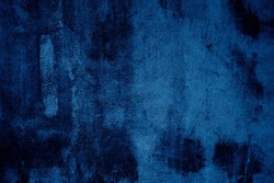 Grunge background of blue concrete wall with scratches