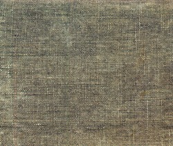 Grunge background of tattered green army camouflage tarpaulin.