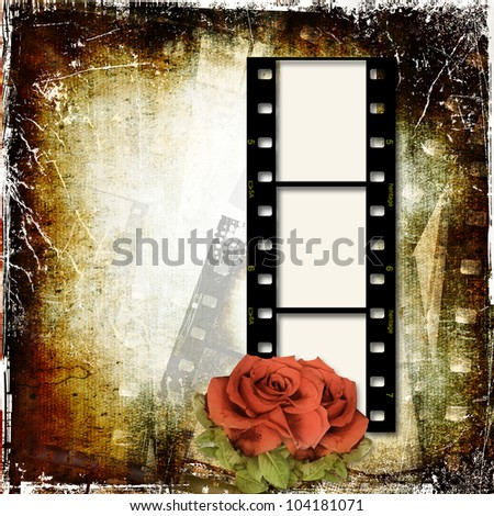 Grunge background with film frame and roses