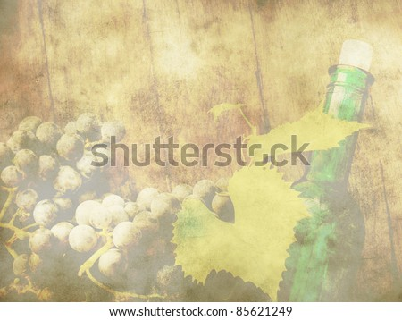 Grunge background with grapes and green bottle on a wooden table