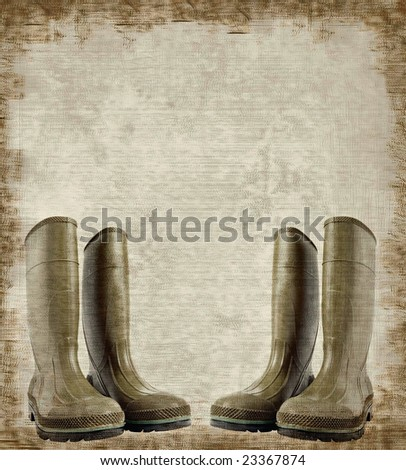 Grunge background with rubber boots