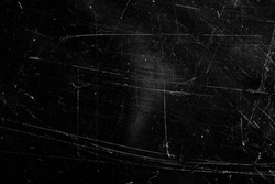 grunge background with scratches on a black background