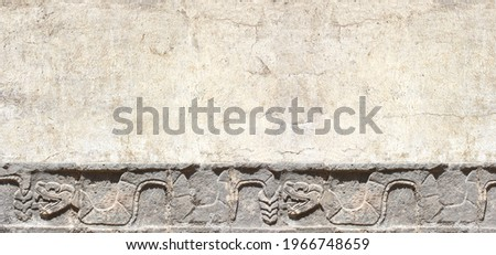 Grunge background with stone wall texture and bas-relief carving of a snake. Horizontal banner with copy space for text. Mock up template Stockfoto ©