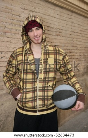 grunge basket ball street player on brickwall with cup