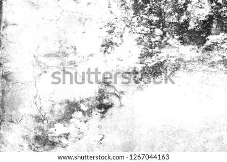Grunge black and white texture. Abstract monochrome pattern of cracks, scuffs, chips, stains, ink spots, lines. Dark design background surface. #1267044163