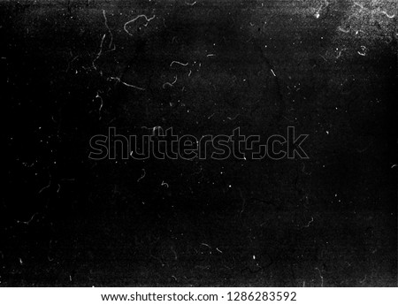 Grunge black scratched background, old film effect, distressed scary texture  #1286283592