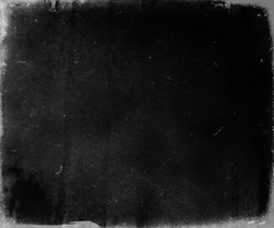 Grunge black scratched background, old film effect, scary distressed texture, copy space