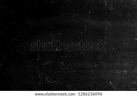 Photo of  Grunge black scratched scary background, old film effect, dusty texture