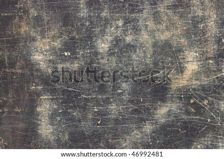Grunge Blue Textured Surface with Horizontal Scratches.  Taken from genuine vintage well traveled antique suitcase.