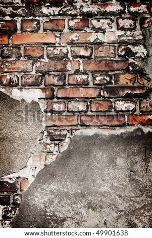 Grunge brick wall texture with concrete remains.