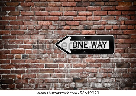 Grunge Brick Wall with Black and White One Way Sign