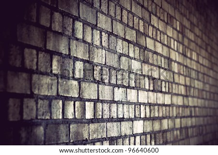 grunge brick wall with diminishing perspective