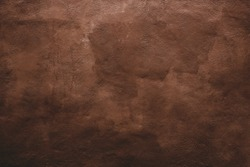 Grunge brown wall. Background texture of an painted wall