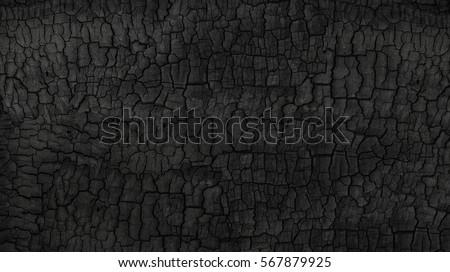 Grunge. Burned wood texture. Black background stock photo
