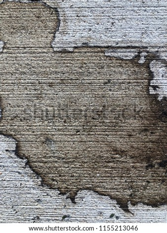 Grunge cement texture background with brown grungy stain and old scratch marks in vintage earthy colors