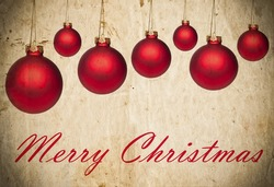 Grunge Christmas background with red Christmas ornaments