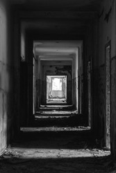 Grunge corridor in abandoned house in black and white