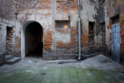 Grunge dark alley, slums of the city, squalid dirty corner of street in the decadent old town