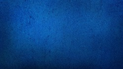 grunge dark blue gradient stucco wall background. abstract grainy blue wall background with space for text.