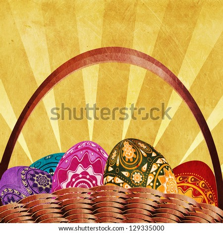 Grunge easter card with woven basket of colorful eggs.
