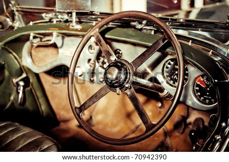 grunge effect classic car steering wheel and dash