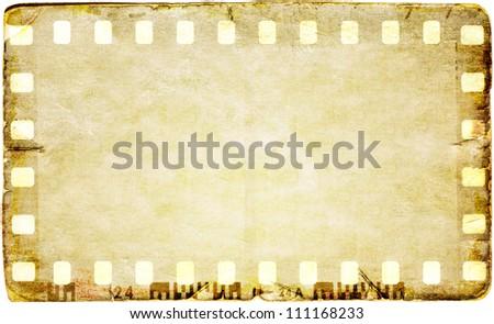 Grunge film strip frame on old paper sheet