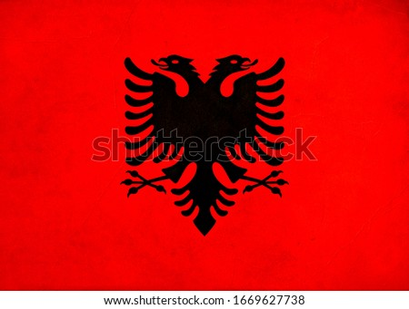 Grunge Flag of Albania , Albania flag pattern on the concrete wall, flag of Albania banner on scratched vintage texture, retro effect , Background for design in country flag