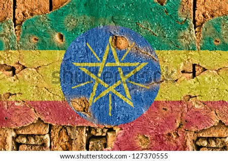 Grunge flag of Ethiopia on old wall background.