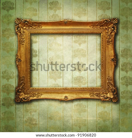 grunge floral faded wallpaper with golden vintage empty frame