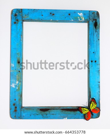 Grunge frame. Grunge blue frame with butterfly on white background    #664353778