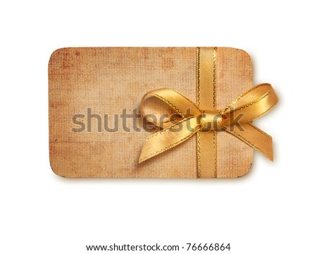 grunge gift tag with gold ribbon bow isolated