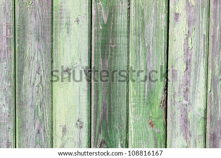 Grunge green painted wooden wall