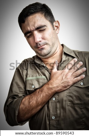 Grunge image of a man with chest pain or having a heart attack