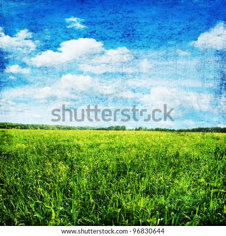 Grunge image of field and sky.