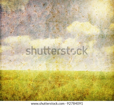 grunge image of green field and ...