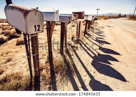grunge mail boxes in a row at...