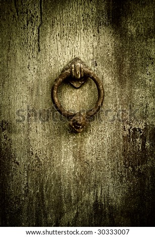 Grunge medieval background - rusty antique door knocker