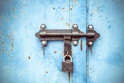 Grunge metal door locked texture.