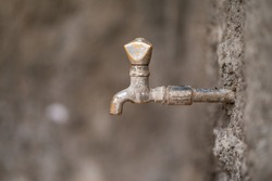 Grunge Metal Water Faucet. Rusted iron water tap.