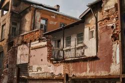 Grunge neglected destroyed city house back side