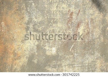 Grunge, old, battered gray and beige painted wall, with black and brown spots, background texture, close up