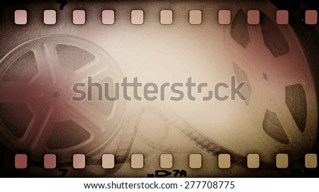 Grunge old motion picture reel with film strip. Vintage background