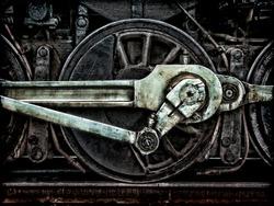 Grunge old steam locomotive wheel and rods