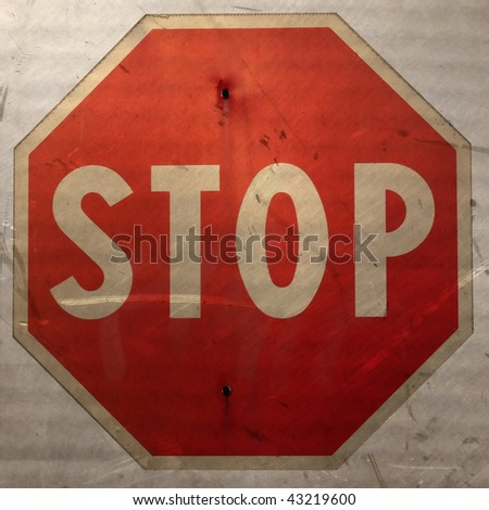 Grunge old stop traffic sign