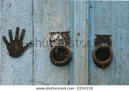 Grunge painted door details with rusty metal handle