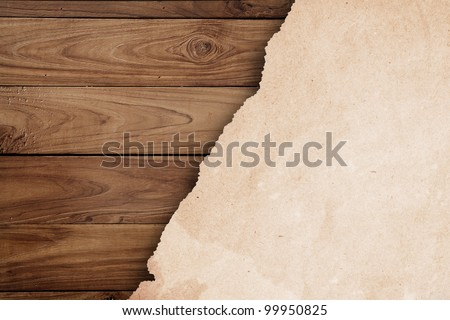 grunge paper on wooden wall.