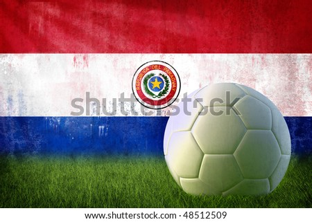 Grunge paraguay flag on wall and soccer ball stock photo
