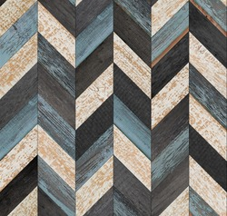 Grunge parquet floor with chevron pattern. Weathered wood texture background. Seamless vintage wooden wall. Old rough wooden surface.