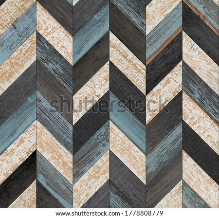 Photo of  Grunge parquet floor with chevron pattern. Weathered wood texture background. Seamless vintage wooden wall. Old rough wooden surface.